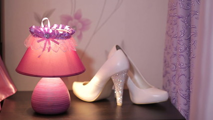 beautiful light and women's shoes on the table