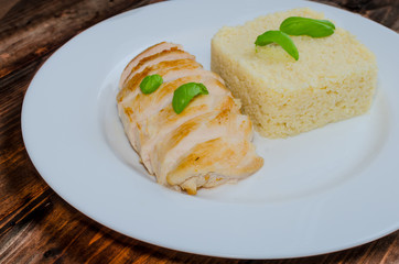 Grilled chicken breast with couscous and basil