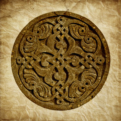 Medieval Armenian ornament on cross stone over paper background