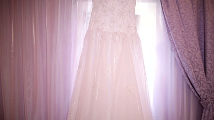beautiful dress of bride on a background of curtains