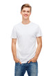 Leinwanddruck Bild - smiling young man in blank white t-shirt