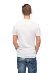 young man in blank white t-shirt from back