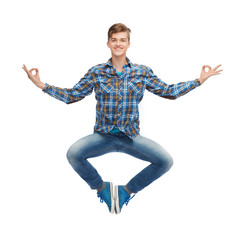 smiling young man flying in air
