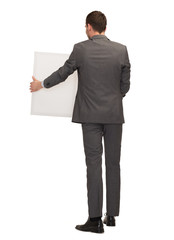 businessman or teacher with white board from back