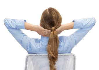 businesswoman sitting on chair from back