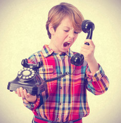 Boy talking by phone and shouting