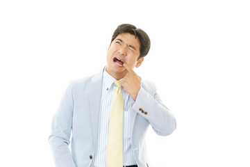 虫歯が痛む男性