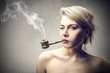 attractive woman smoking a pipe
