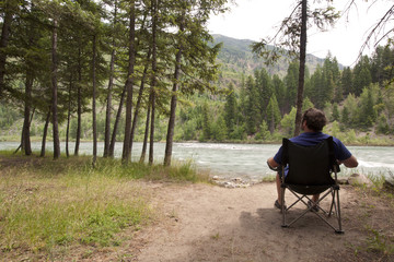 A man relaxing in a chair enjoying the view in Montana.