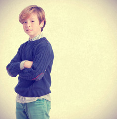 Boy posing with arms crossed