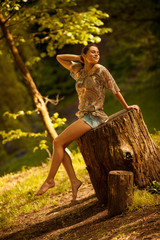 Attractive happy woman joying in beautiful summer day.