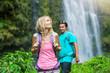 Couple hiking to waterfall