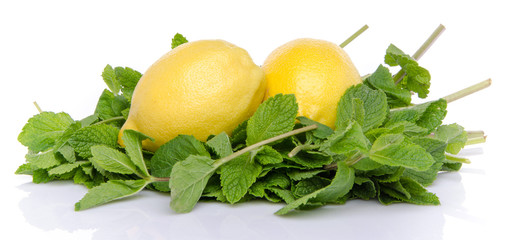 Two lemons on a bed of fresh mint