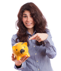 Happy girl holding a piggy bank