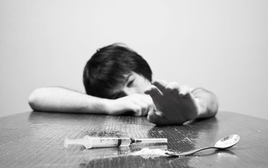 young addict pulls arm Drugs