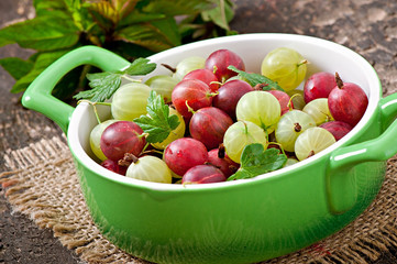 green and red gooseberries in a bowl
