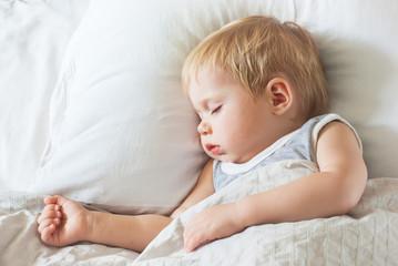 Sweet Little Boy Sleeping on Bed