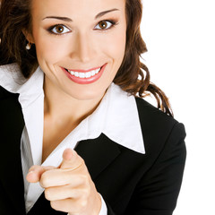Businesswoman pointing finger at viewer, on white