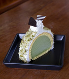 Greentea icecream cake on wood table poster