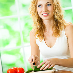 Young woman making fegetarian salad at home