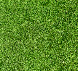 Green background of football field grass texture