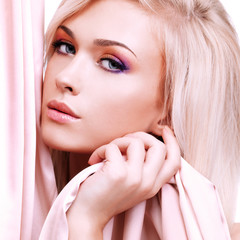 Beautiful sensual woman with pink silk.