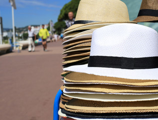 Hats laid out on the waterfront of the French Riviera