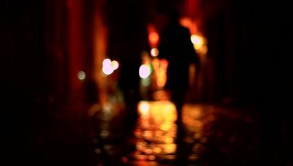 Blurred people on night street.