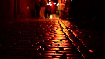 Unknown people on dark street