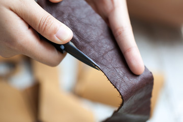 human working on leather