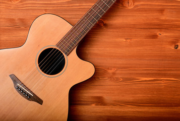 Close-up western guitar on wooden background