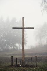 Christian cross in the fog