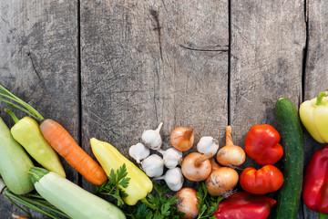 Fresh vegetables on vintage wooden background