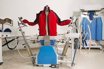 Dry cleaning center with steam machine