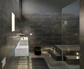 detail of a glass washbasin in a modern bathroom
