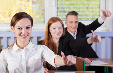Students with okay gesture