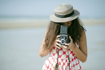 Woman With Vintage Camera On Beach