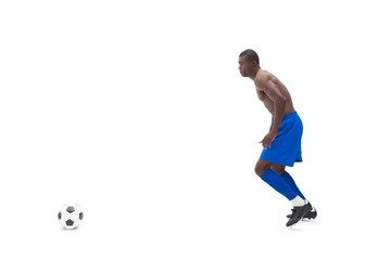 Shirtless football player moving to the ball