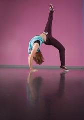 Pretty break dancer bending backwards with leg up
