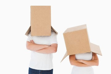 Mature couple wearing boxes over their heads