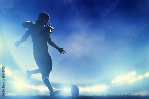 American football player kicking the ball, kickoff - 68242000