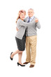 Full length portrait of a mature couple dancing tango