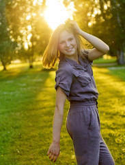 Portrait of young woman in stylish overalls