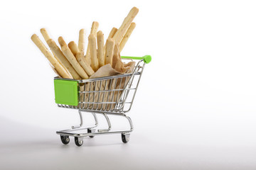 Bread sticks in a shopping cart