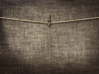 clothesline with clothespins on linen background