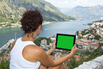 Girl with tablet computer with green screen