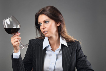 Beautiful woman looking at wineglass