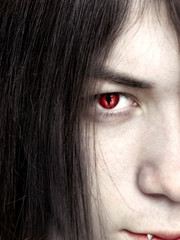 face of a young male vampire close up