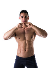 Shirtless man making heart symbol