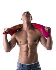 Male model drying himself with towel